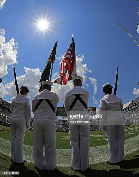 Members of the United States Navy present the colors during a game between the Jacksonville Jaguars and the Green Bay Packers at EverBank Field on...