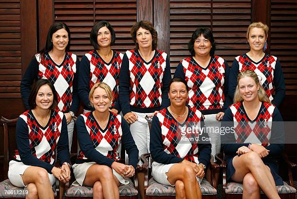 Members of the United States Solheim Cup team pose for a picture after the rainshortened and canceled 2007 LPGA NW Arkansas Championship presented by...