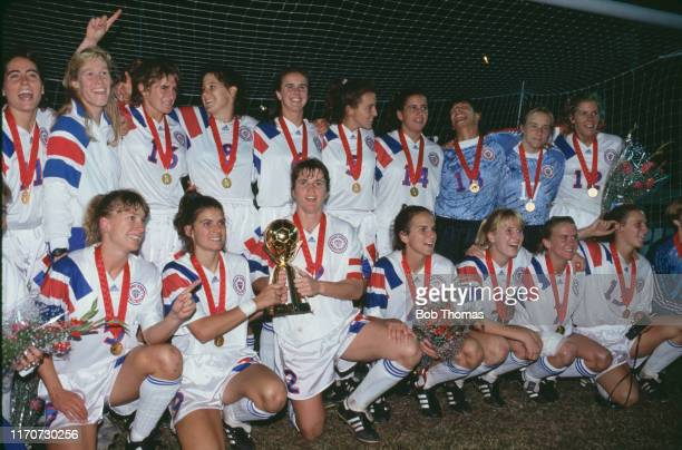 Members of the United States squad celebrate with the trophy after the United States team beat Norway 2-1 in the final of the 1991 FIFA Women's World...