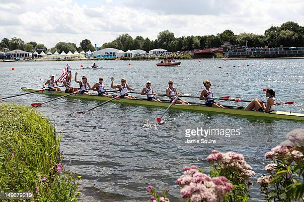 Members of the United States team celebrate in their boat with their gold medals after the medal ceremony for the Women's Eight final on Day 6 of the...
