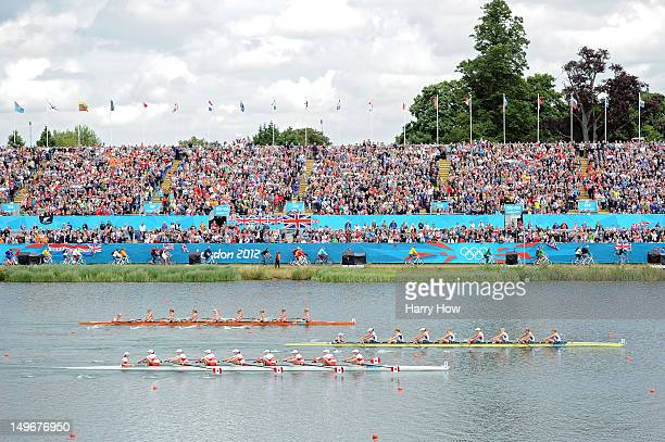 Members of the United States team lead the Canada and Netherlands teams on their way to winning gold during the Women's Eight final on Day 6 of the...