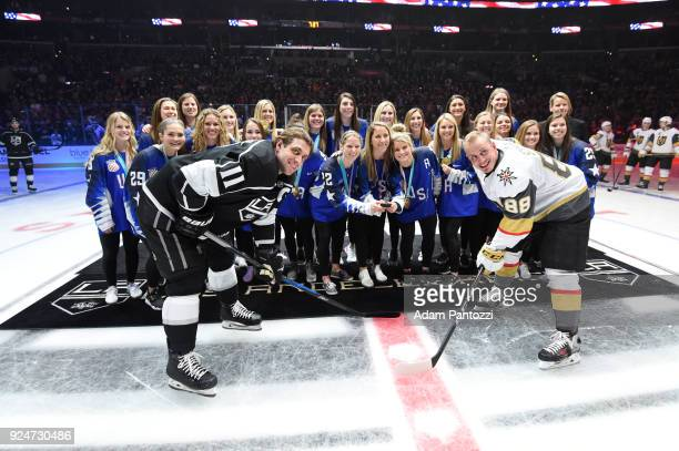 Members of the United States Women's Hockey Team participate in a ceremonial puck drop alongside Anze Kopitar of the Los Angeles Kings and Nate...