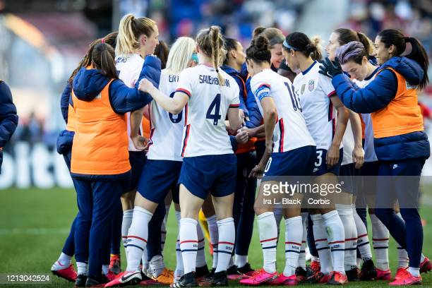 Members of the United States Women's National Team huddle at the start of the 2nd half of the 2020 SheBelieves Cup match between United States and...