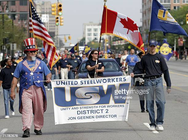 Members of the United Steel Workers union march in the Detroit Labor Day Parade September 4 2006 in Detroit Michigan