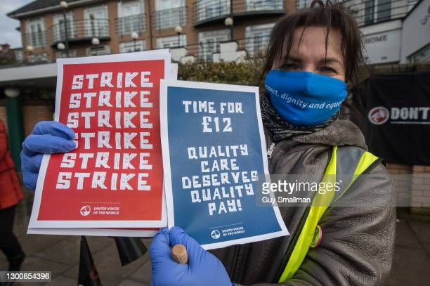 Members of the United Voices of the World trade union hold a socially distanced picket of their work place, the SAGE care home in Brent, during a...