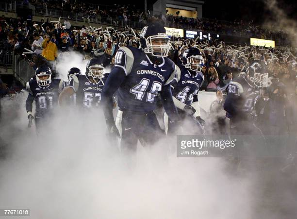Members of the University of Connecticut Huskies run onto the field against the Rutgers Scarlet Knights at Rentschler Field November 3, 2007 in East...