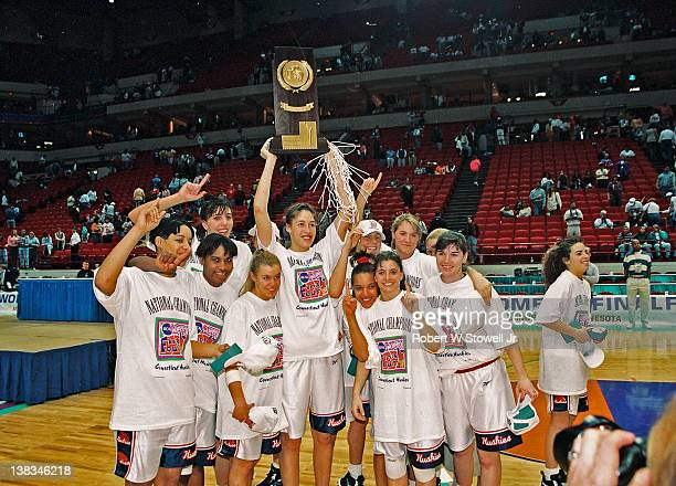 Members of the University of Connecticut women's basketball team celebrate after their victory in the NCAA Women's National Championship Minneapolis...