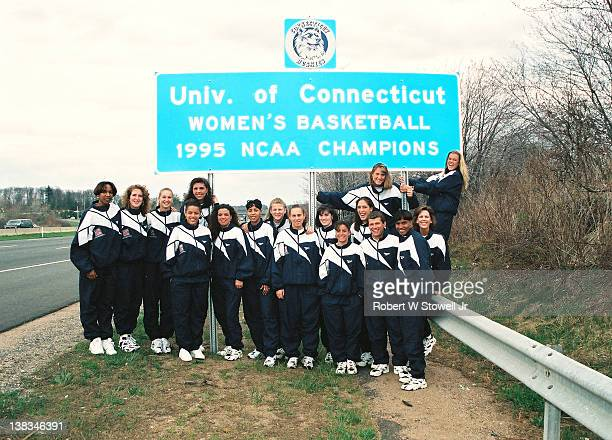 Members of the University of Connecticut's NCAA national championshipwinning women's basketball team pose next to a roadsign erected in their honor...