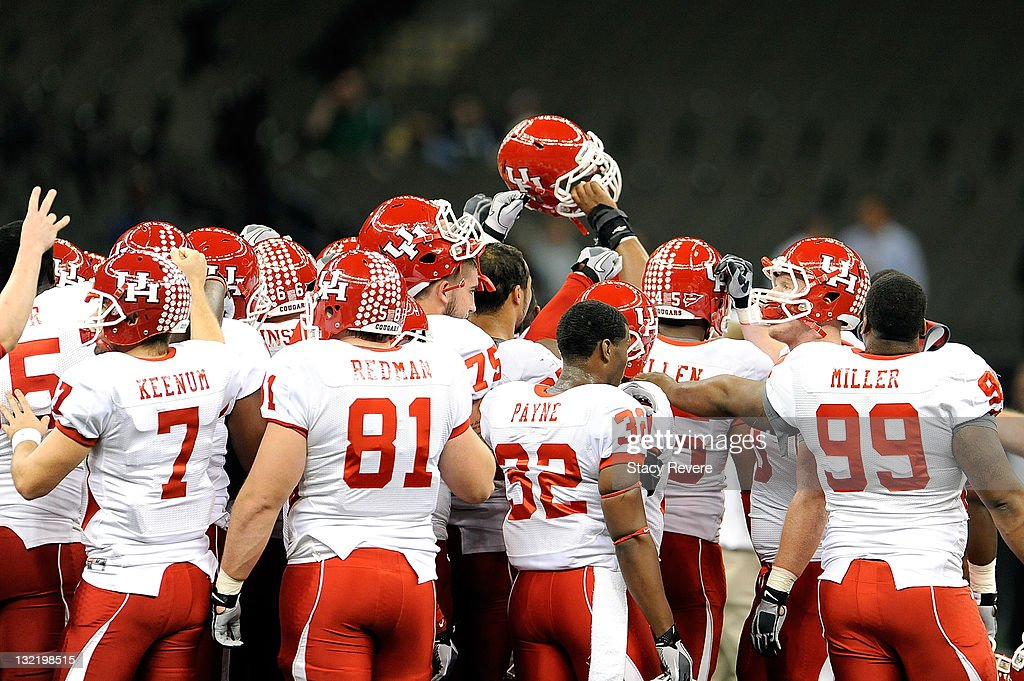 Members of the University of Houston Cougars gather at midfield prior to a game against the Tulane Green Wave being held at the Mercedes-Benz Superdome on November 10, 2011 in New Orleans, Louisiana.