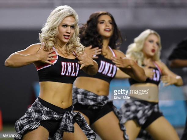 Members of the UNLV Rebels dance team perform during the team's game against the San Jose State Spartans at Sam Boyd Stadium on September 30 2017 in...