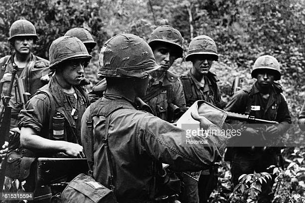 Members of the US 173rd Airborne Brigade map their plans for hunting the Viet Cong during jungle operations