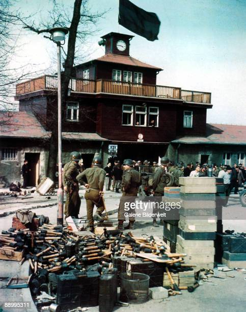 Members of the US 5th Ranger Infantry Battalion outside the newlyliberated Buchenwald Concentration Camp Germany April 1945 In the foreground is a...