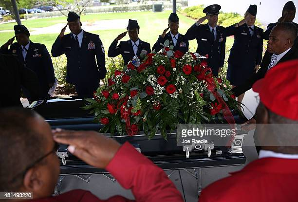 Members of the US Air Force 482nd Fighter Wing Honor Guard along with members of the Tuskegee Airmen organization salute as the casket of retired Air...