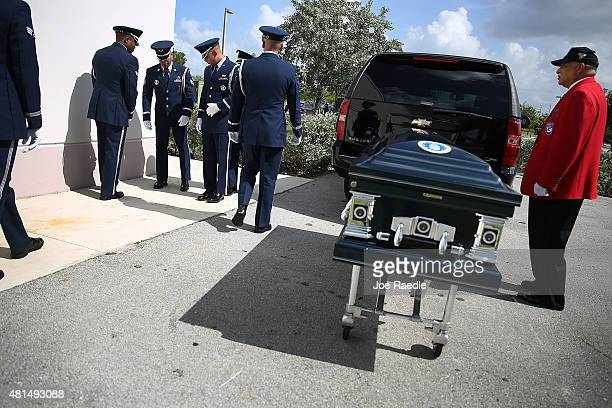 Members of the US Air Force 482nd Fighter Wing Honor Guard and Herbert Otey prepare to bring the casket of retired Air Force Lt Col Eldridge Williams...