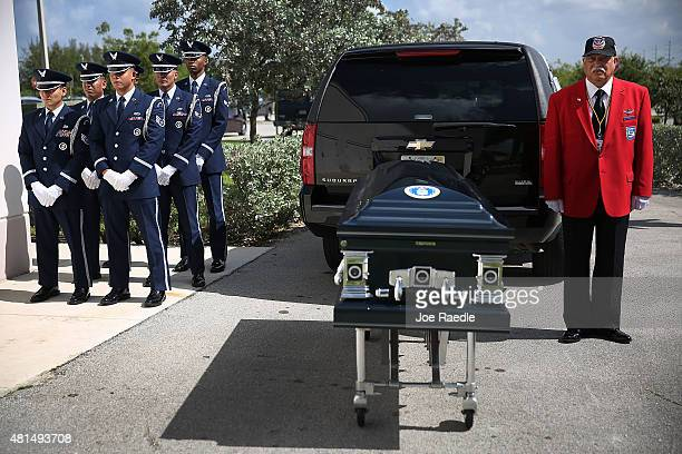 Members of the US Air Force 482nd Fighter Wing Honor Guard and Herbert Otey from Tuskegee Airmen inc prepare to bring the casket of retired Air Force...