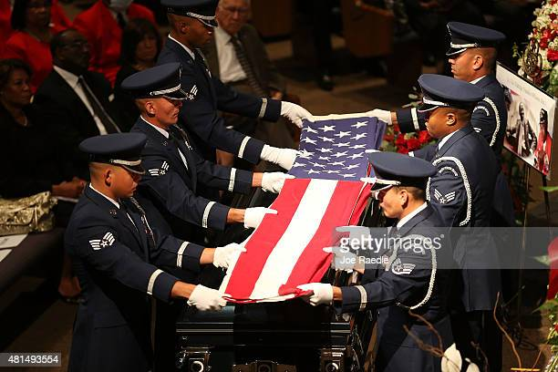 Members of the US Air Force 482nd Fighter Wing Honor Guard fold the American flag to deliver to a family member during the funeral of retired Air...