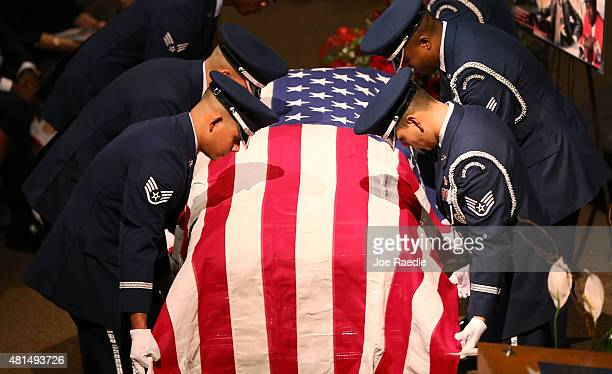 Members of the US Air Force 482nd Fighter Wing Honor Guard prepare to fold the American flag to deliver to a family member during the funeral of...