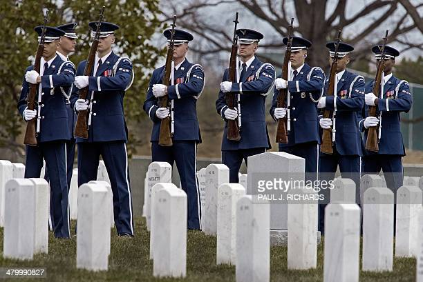 Members of the US Air Force Honor Guard Firing Party line up during burial services for the remains of seven US military service members from the...