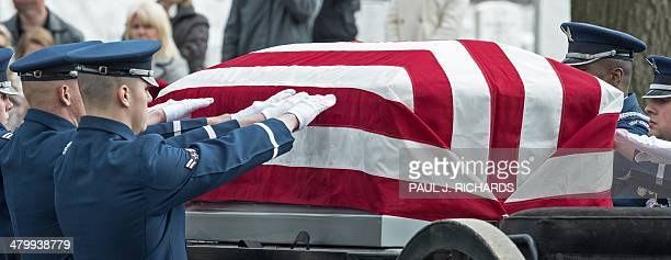 Members of the US Air Force Honor Guard reach out to off load the casket from the caisson bearing the remains of seven killed US military service...