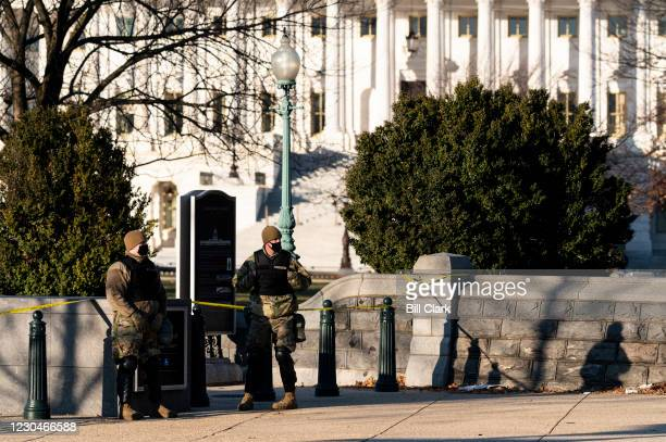 Members of the U.S. Air Force stand guard at Constitution Avenue and 2nd Street NE on the U.S. Capitol grounds on Thursday morning, January 7...