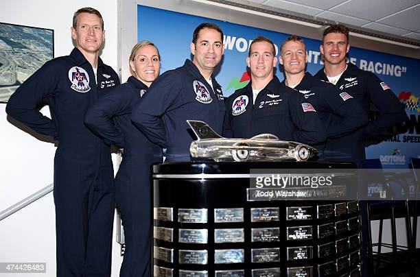 Members of the US Air Force Thunderbirds pose with the Harley J Earl Trophy prior to the NASCAR Sprint Cup Series Daytona 500 at Daytona...