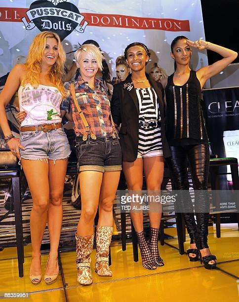Members of the US all women singing group the Pussycat Dolls Ashley Roberts Kimberly Wyatt Melody Thornton and Nicole Scherzingeron pose for a photo...
