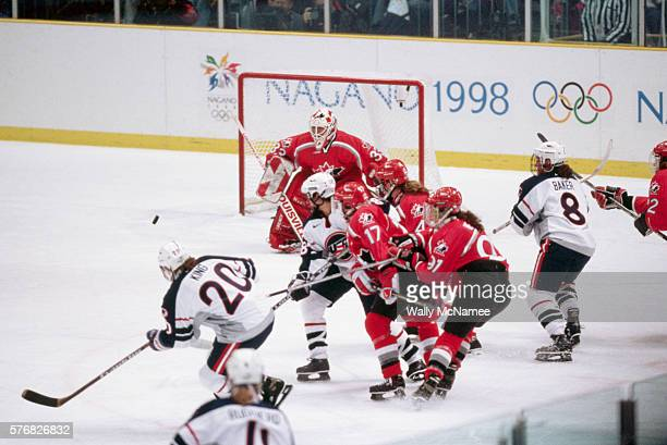 Members of the US and Canadian women's ice hockey teams in front of the goal during the final game at the 1998 Winter Olympics The Americans win the...