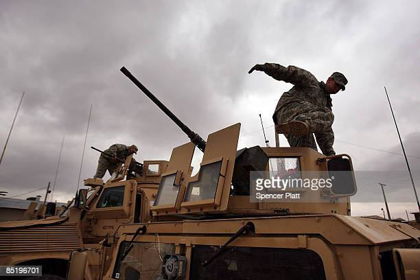 Members of the U.S. Army 101st Airborne Division prepare for a mission on March 3, 2009 at Bagram Air Base, Afghanistan. As the security situation...