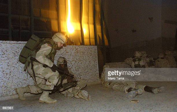 Members of the US Army 101st Airborne respond after enemy gunfire erupted as a plane carrying 20 Taliban and al Qaeda detainees took off from...