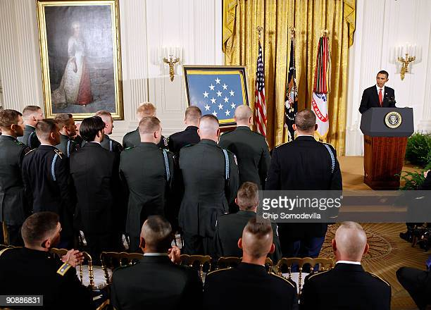 Members of the US Army 10th Mountain Division unit that were with Sergeant First Class Jared C Monti when he was killed stand and are recognized by...