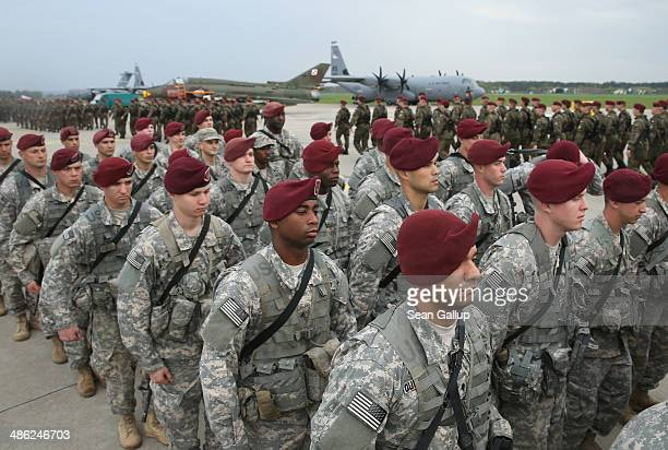 Members of the US Army 173rd Airborne Brigade march past a Polish paratrooper unit after a ceremony upon the US troops' arrival by plane at a Polish...