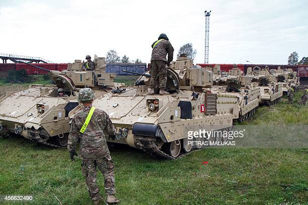 Members of the US Army 1st Brigade 1st Cavalry Division unload Bradley Fighting Vehicles at the railway station near the Rukla military base in...