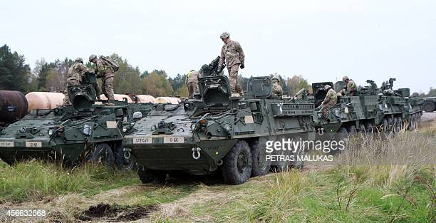 Members of the US Army 1st Brigade 1st Cavalry Division unload Stryker Armored Vehicles at the railway station near the Rukla military base in...
