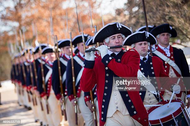 Members of the US Army 3rd Infantry Regiment and The Old Guard Fife and Drum Corps march on the grounds of George Washington's Mount Vernon Estate...