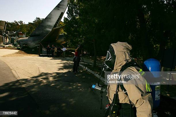 Members of the US Army 9th Civil Support Team are first to respond during to an exercise simulating mass casualties from the collision between a...