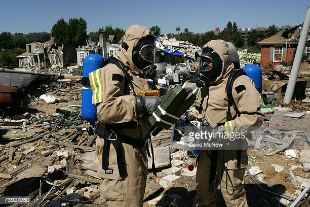 Members of the US Army 9th Civil Support Team evaluate hazards as the first responders in the crash zone during an exercise simulating mass...
