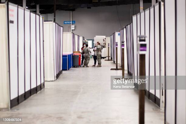 Members of the U.S Army are seen inside the New Jersey Convention Center on April 8, 2020 in Edison, New Jersey. Workers set up a field medical...