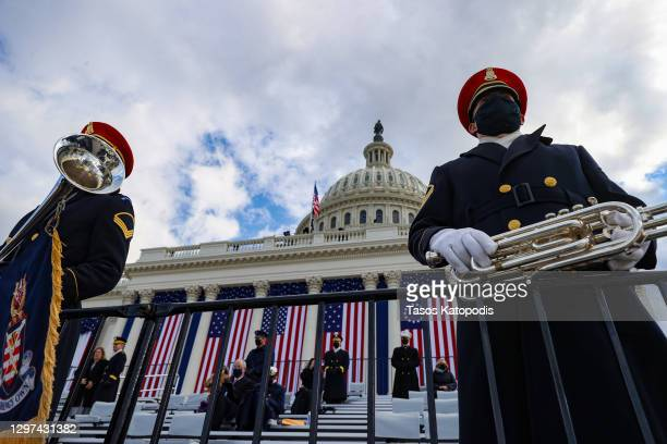 """Members of the U.S. Army Band """"Pershing's Own"""" look on ahead of the inauguration of U.S. President-elect Joe Biden on the West Front of the U.S...."""