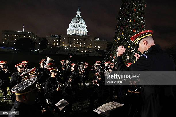 Members of the US Army Band 'Pershing's Own' perform during the lighting ceremony of the 2011 Capitol Christmas Tree at the West Front of the Capitol...