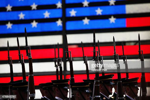 Members of the US Army Drill Team perform in Times Square in New York City in honor of the Army's 240th birthday on June 12 2015 in New York City...