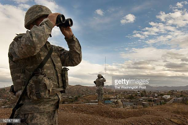 Members of the US Army National Guard keep watch along the US Mexico border in Nogales Arizona on Thursday December 16 2010 More than Guardsmen are...
