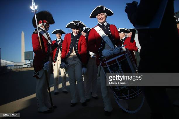Members of the US Army Old Guard Fife and Drum Corps gather after performing on the National Mall as Washington prepares for President Barack Obama's...