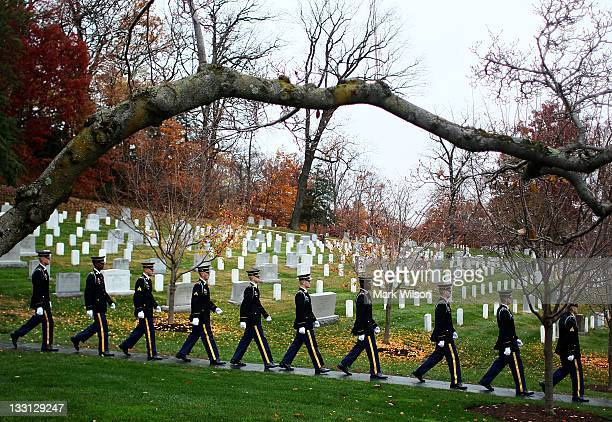 Members of the US Army Old Guard walk away after a wreathlaying ceremony at President John F Kennedy's gravesite at Arlington Cemetery on November 17...