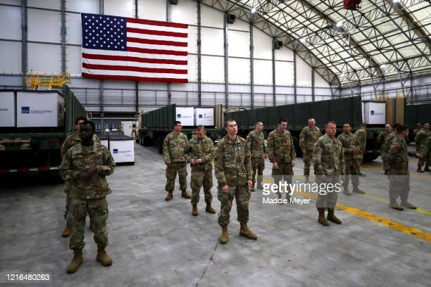 Members of the US Army prepare to receive N95 masks from Shenzhen China delivered to Logan International Airport by the New England Patriots plane on...