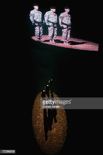 Members of the US Army Repelling Unit stand for the National Anthem during the Professional Bull Riders World Finals at Mandalay Bay Casino and Hotel...