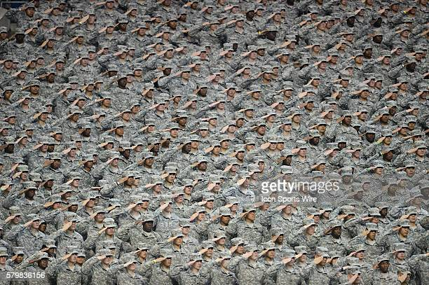 Members of the US Army salute during the national anthem before the US Army AllAmerican Bowl in the Alamodome in San Antonio Texas