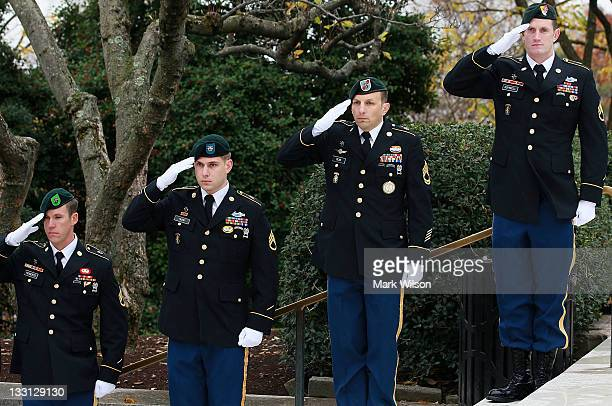 Members of the US Army Special Forces salute during a wreathlaying ceremony at President John F Kennedy's gravesite at Arlington Cemetery on November...