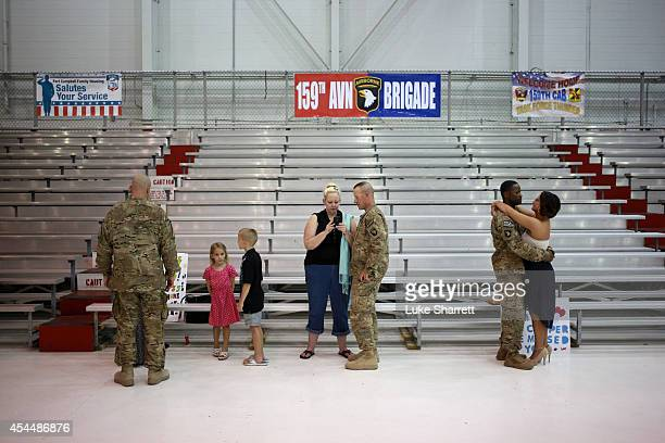 Members of the US Army's 159th Combat Aviation Brigade 101st Airborne Division reunite with loved ones following a homecoming ceremony at Campbell...