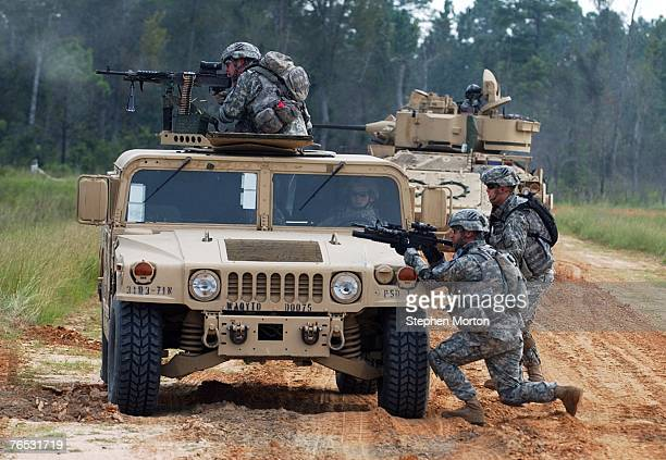 Members of the U.S. Army's 3rd Infantry Division, 4th Brigade Combat Team train during a live fire exercise from their humvees prior to deployment to...