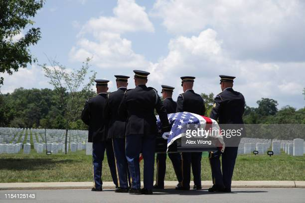 Members of the US Army's 3rd Infantry Regiment The Old Guard carry the flagdraped casket of World War II Army veteran Carl Mann to his final resting...